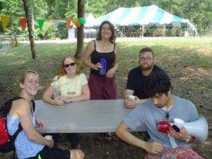 alumni at picnic table