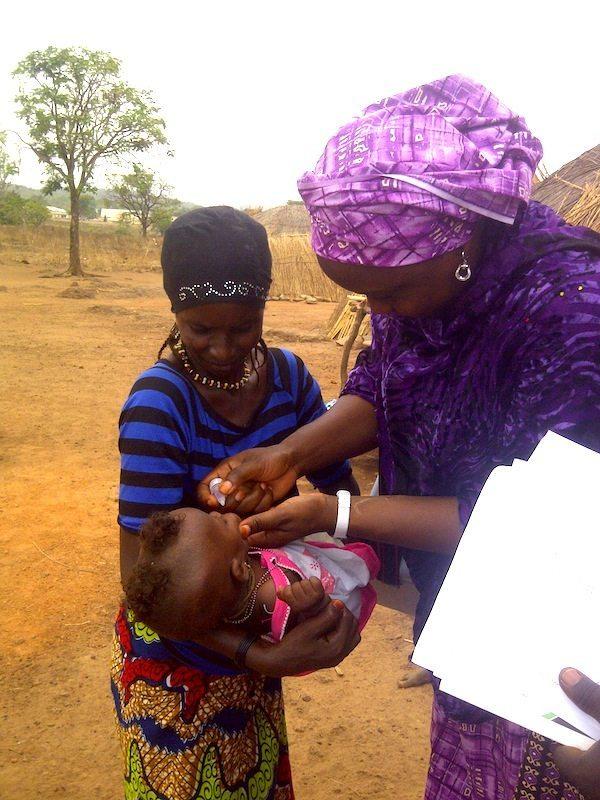Dr. Aishatu administers oral vaccine in rural Nigeria