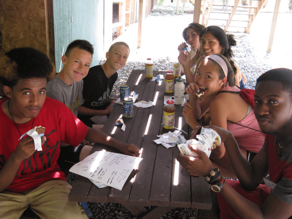 Participants enjoy a relaxing snack at the GYV Cafe!  From bottom left - Sirac, from Erritrea and Seattle; Frank, from Poland; Elijah, from Arizona; Nolwenn from France; Ruby, from Massachusetts and Guatemala; Maddy from Virginia; and Kofi, from Ghana