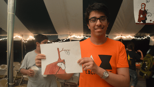 "Nayef, from Saudi Arabia, shows off his ""remix"" of Salvador Dali's ""Persistence of Memory"", which he completed during Arts Night"