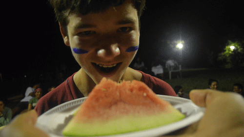 Dan, from New York, competes in the Watermelon eating competition during GYV Wacky Games